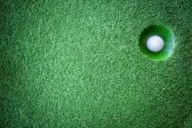 Mini golf scene with ball and hole