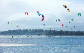 Kitesurfers enjoying wind power on Bulabog beach.