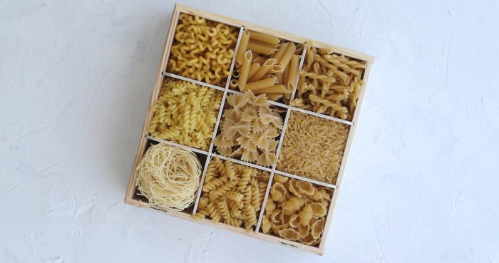 Container with macaroni of different shape